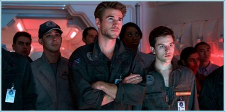 Liam Hemsworth y Travis Tope